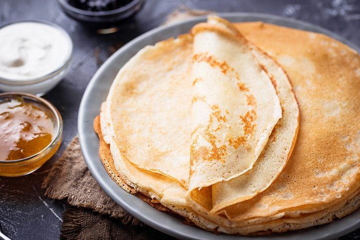 Pancakes crepes with different jam and cream. Top view